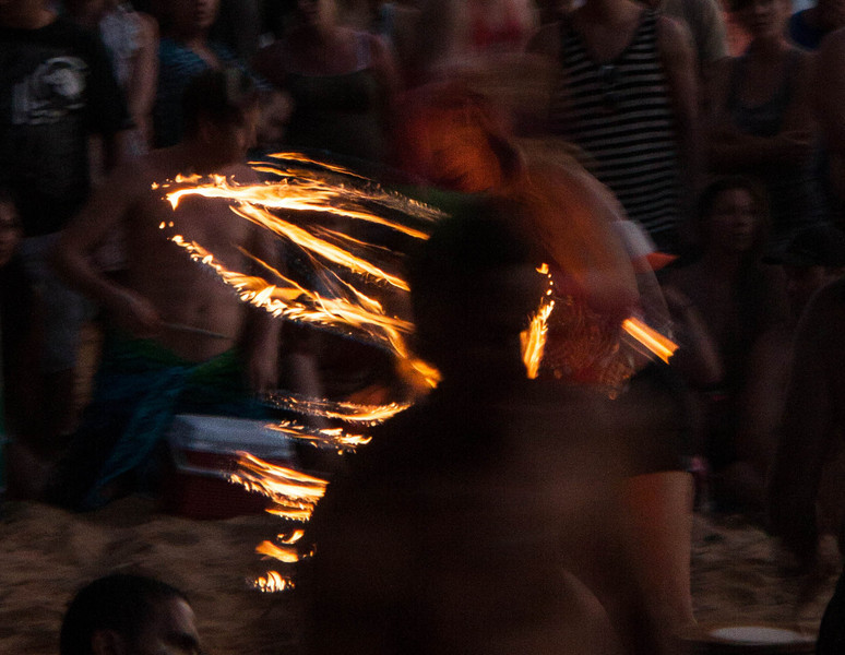 Every Sunday night, there is a beach party on Little Beach at Makena State Park on Maui. Right when the sun disappears below the horizon, the fire dancers start. There are numerous of them, men and women dancing to the beats of the Polynesian drums.