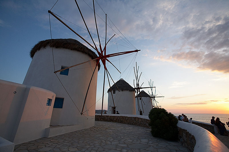 Windmills at sunset in Little Venice (part of Hora, the capital of the island of Mykonos).