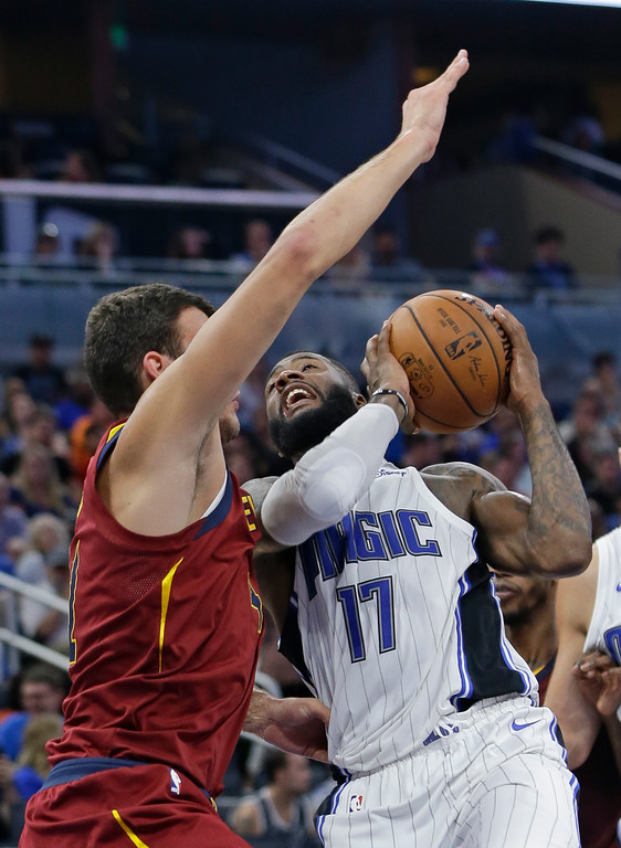 . Orlando Magic\'s Jonathon Simmons (17) looks for a shot against Cleveland Cavaliers\' Ante Zizic during the second half of an NBA preseason basketball game, Friday, Oct. 13, 2017, in Orlando, Fla. (AP Photo/John Raoux)