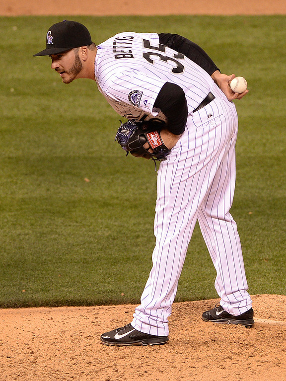 . DENVER, CO - APRIL 18: Colorado reliever Chad Bettis looked for the sign from catcher Wilin Rosario. The Colorado Rockies defeated the Philadelphia Phillies 12-1 Friday night, April 18, 2014 at Coors Field.  (Photo by Karl Gehring/The Denver Post)