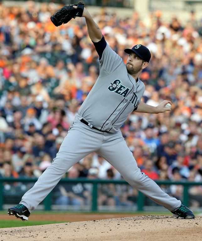 . Seattle Mariners starting pitcher James Paxton throws during the first inning of a baseball game against the Detroit Tigers, Friday, Aug. 15, 2014, in Detroit. (AP Photo/Carlos Osorio)