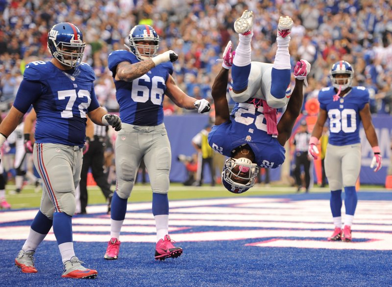 . <p><b> Giants at Bears (-7½):</b>  <p>New York running back David Wilson last Sunday celebrated his first touchdown of the season by doing a double back-flip in the end zone, shattering the NFL record for back-flips performed by a winless team. <p>Pick: <b>Bears by 4</b> <p>     (Maddie Meyer/Getty Images)