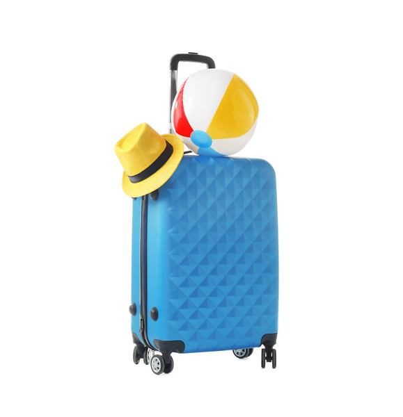 Blue Suitcase With Hat And Inflatable Ball Packed For Journey On White Background