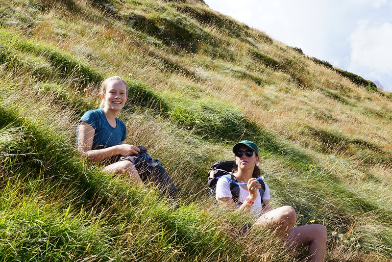 Abigael and Emily hanging out in the high grass