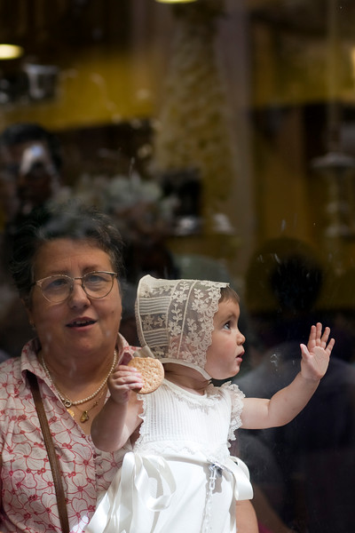 Little baby looking at the Corpus Christi procession, Seville, Spain, 2009.
