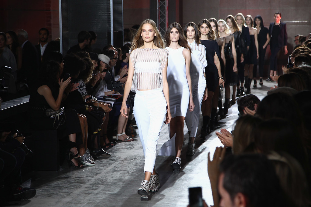 . PARIS, FRANCE - SEPTEMBER 26:  Models run the runway during the IRFE show as part of the Paris Fashion Week Womenswear  Spring/Summer 2014  on September 26, 2013 in Paris, France.  (Photo by Julien M. Hekimian/Getty Images)
