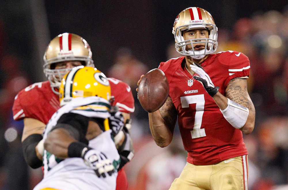 Description of . San Francisco 49ers quarterback Colin Kaepernick (7) passes against the Green Bay Packers during the second quarter of an NFC divisional playoff NFL football game in San Francisco, Saturday, Jan. 12, 2013. (AP Photo/Tony Avelar)