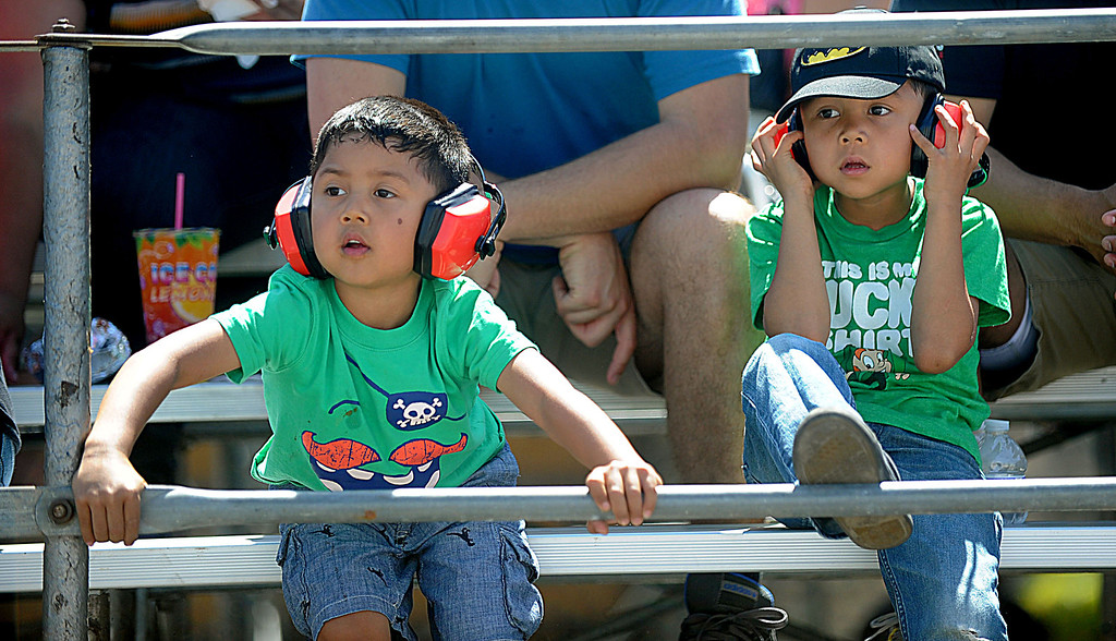 . 04-20-2013-(LANG Staff Photo by Sean Hiller)- Isaiah Teran,4, of Corona,left, and brother Asa, 5, watch the Indycar qualifying race at the Toyota Grand Prix of Long Beach Saturday.