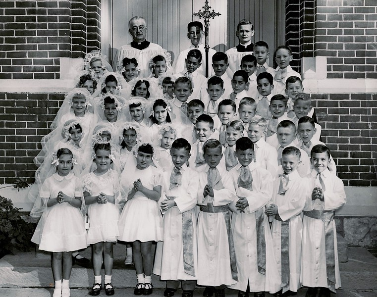 Urbana kids who went to St. Mary's School (and some public school kids who went to St. Pat's). This was taken in May 1954 at St. Patrick's Church in Urbana. First Communion.