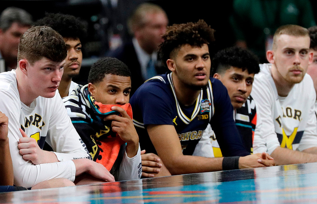 . Players on the Michigan bench react as they watch during the second half in the championship game of the Final Four NCAA college basketball tournament against Villanova, Monday, April 2, 2018, in San Antonio. (AP Photo/David J. Phillip)