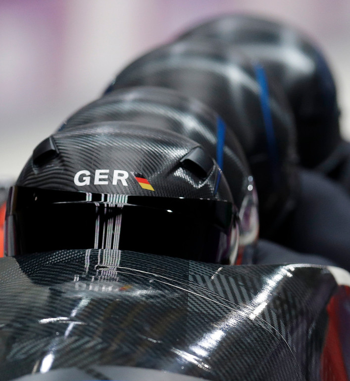 . The team from Germany GER-3, with Thomas Florschuetz, Joshua Bluhm, Kevin Kuske and Christian Poser, start their first run during the men\'s four-man bobsled competition at the 2014 Winter Olympics, Saturday, Feb. 22, 2014, in Krasnaya Polyana, Russia. (AP Photo/Natacha Pisarenko)