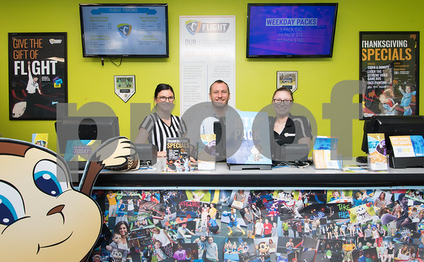 11/20/17 Wesley Bunnell | Staff Party Coordinator Savanna Costa, Manager Marcus Diggle and Court Monitor Victoria Tanguay of Flight Trampoline Park in New Britain stand in front of the Wall of Smiles and Flight's mascot Jet.