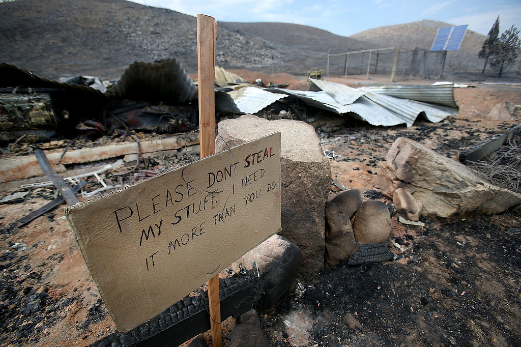 . A sign is posted Tuesday, Aug. 13, 2013 by the remains of Bill Corlett\'s home that burned during a wildfire on Aug. 8, 2013 northwest of Fairfield, Idaho.   (AP Photo/The Times-News, Ashley Smith)