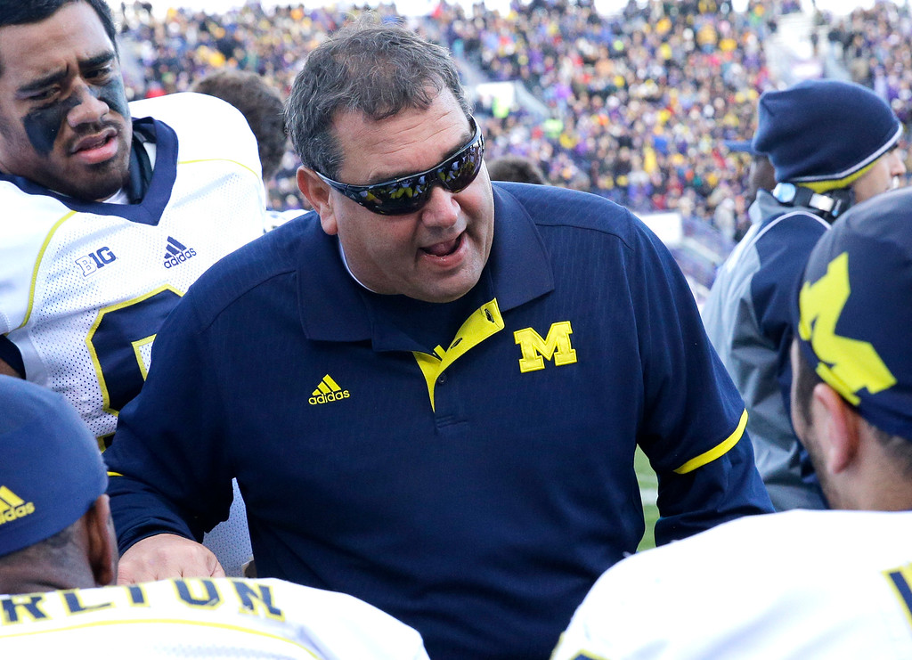 . Michigan head coach head coach Brady Hoke talks to his team during the first half of an NCAA college football game against Northwestern in Evanston, Ill., Saturday, Nov. 8, 2014. (AP Photo/Nam Y. Huh)