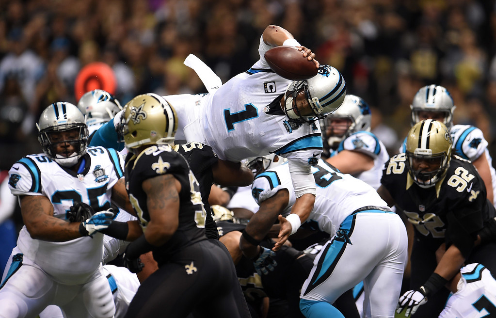 . NEW ORLEANS, LA - DECEMBER 07:  Cam Newton #1 of the Carolina Panthers scores a touchdown during the first quarter against the New Orleans Saints at Mercedes-Benz Superdome on December 7, 2014 in New Orleans, Louisiana.  (Photo by Stacy Revere/Getty Images) *** BESTPIX ***