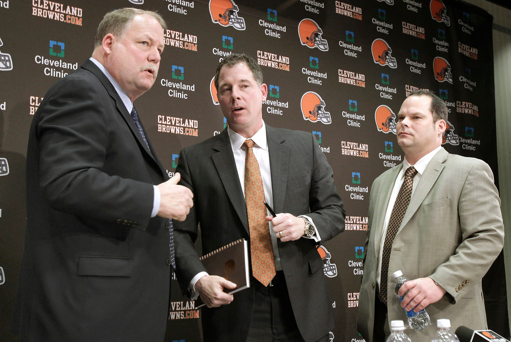. Cleveland Browns President Mike Holmgren, left, new head coach Pat Shurmur, center, and Browns General Manager Tom Heckert, right,  speak together after a news conference where Shurmur was presented to the media at the Browns training facility in Berea, Ohio on Friday, Jan. 14, 2011.   (AP Photo/Amy Sancetta)