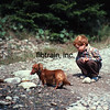 Trent & his friend Hilde study the ocean bay at Point Wolfe, Fundy National Park, New Brunswick, Canada.  9/1982.