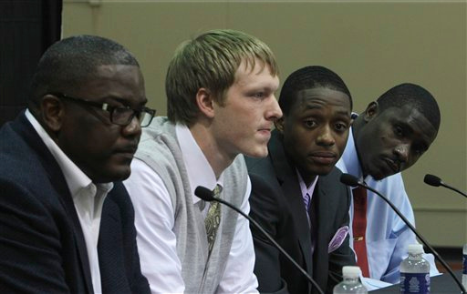 . Detroit Pistons team president of basketball operations Joe Dumars, left, sits with draft picks Kyle Singler, Brandon Knight, and Vernon Macklin, far right, at the team\'s practice facility in Auburn Hills, Mich., Saturday, June 25, 2011. (AP Photo/Carlos Osorio)