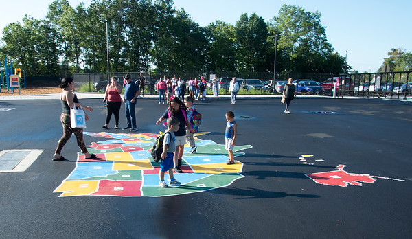 09/03/19 Wesley Bunnell | StaffrrStudents play on a map of the United States on a fenced in playground before their first day of school at Smalley School on Tuesday September 3, 2019.