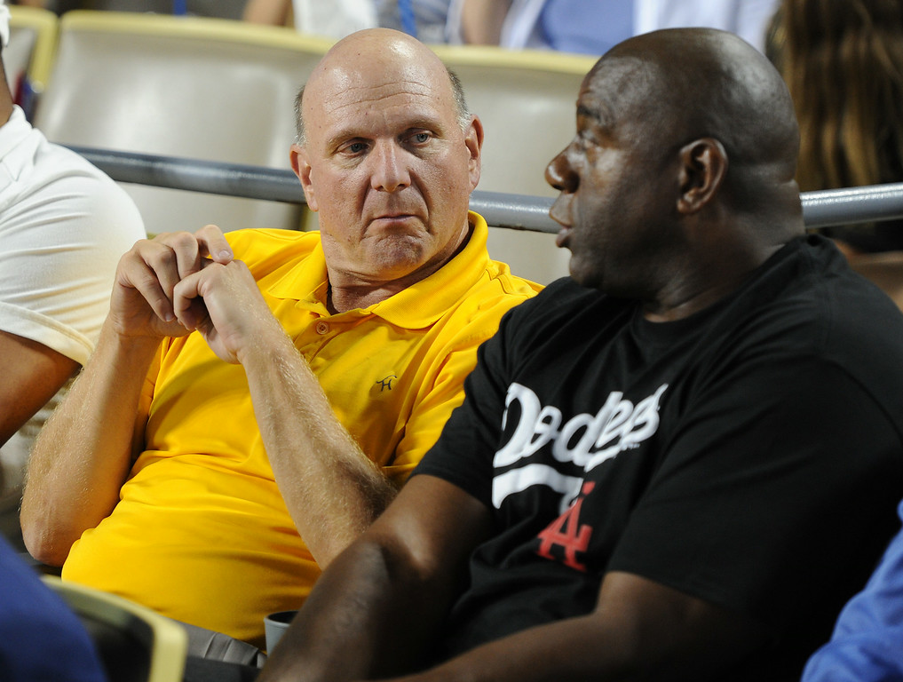 . Clipper Owner Steve Ballmer sits next to Dodgers Owner Magic Johnson during a game against the San Diego Padres at Dodger Stadium. Los Angeles, CA. 8/19/2014(Photo by John McCoy Daily News)