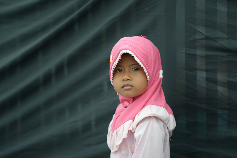 . An Indonesian Muslim girl stands during a mass prayer to celebrate Muhammad\'s birthday in Jakarta on January 14, 2014. Thousands of Muslims in Indonesia celebrated the birthday of prophet Muhammad called Mawlid or locally maulud, which occurs in the third month in the Islamic calendar. (ADEK BERRY/AFP/Getty Images)