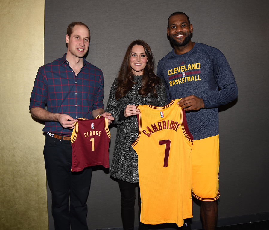 . Prince William, Duke of Cambridge and Catherine, Duchess of Cambridge pose with basketball player LeBron James (R) backstage as they attend the Cleveland Cavaliers vs. Brooklyn Nets game at Barclays Center on December 8, 2014 in the Brooklyn borough of New York City. (Photo by Tim Rooke - Pool/Getty Images)