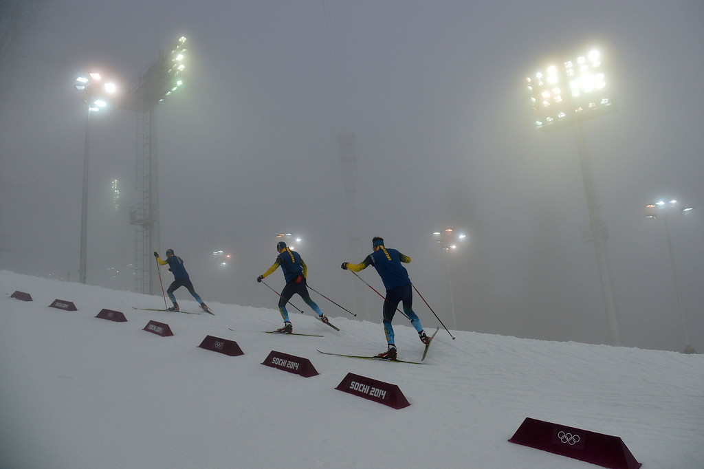 . Members of the Swedish team test the track as the Men\'s Biathlon 15 km Mass Start has been delayed due to a heavy fog at the Laura Cross-Country Ski and Biathlon Center during the Sochi Winter Olympics on February 16, 2014, in Rosa Khutor, near Sochi.  ALBERTO PIZZOLI/AFP/Getty Images