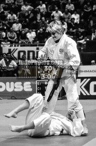 1989 Belgrade Worlds 891015B0819b:  Karen Briggs of Great Britain jumps to her feet after holding Fumiko Ezaki of Japan to win the gold medal ....