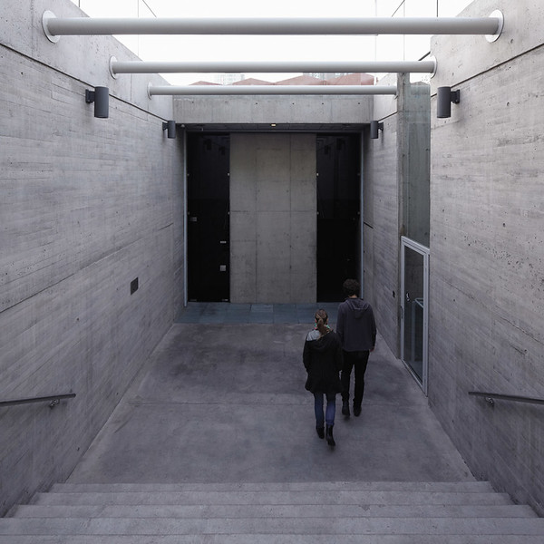 At the base of the stairs, visitors enter the memorial's sealed inner chamber to the right. (Courtesy Alfredo Jaar Studio)