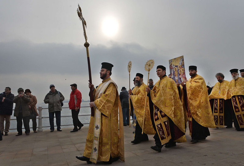 . Romanian Orthodox priests walk along the border of the Black Sea during Epiphany celebrations in Constanta, 250 km east from Bucharest, on January 6, 2014.     DANIEL MIHAILESCU/AFP/Getty Images