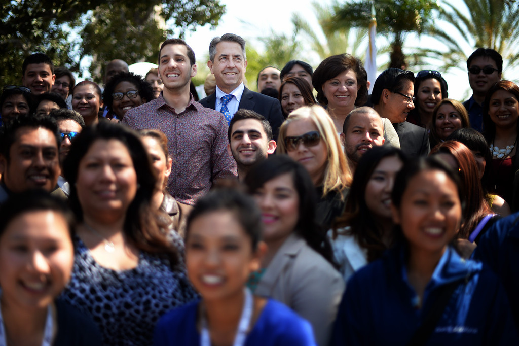 . Peter Lee, executive director for Covered California, center, poses for a photo during a rally on Olvera Street  to help kick off the final two weeks of health care enrollment through Covered California Thursday, March 13, 2014.  (Photo by Hans Gutknecht/Los Angeles Daily News)
