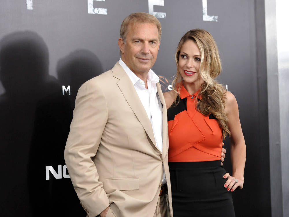 """. Actor Kevin Costner, left, and wife Christine Baumgartner attend the \""""Man Of Steel\"""" world premiere at Alice Tully Hall on Monday, June 10, 2013 in New York. (Photo by Evan Agostini/Invision/AP)"""