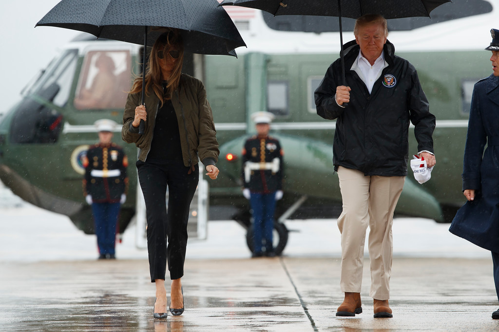 . President Donald Trump and first lady Melania Trump walk rom Marine One to board Air Force One  at Andrews Air Force Base, Md., Tuesday, Aug. 29, 2017, for a trip to Texas to get an update on Hurricane Harvey relief efforts. (AP Photo/Evan Vucci)