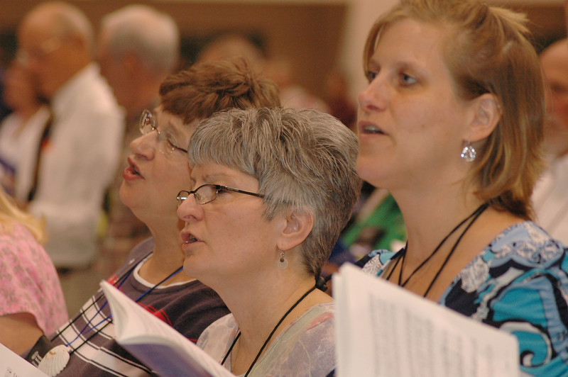 Time for a hymn during plenary session eight.