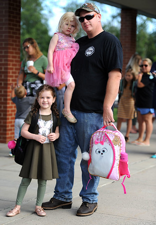 8/28/2019 Mike Orazzi | Staff Jim Hill with his children Madison and McKenzie on the first day back to school at the Plymouth Center School on Wednesday morning.