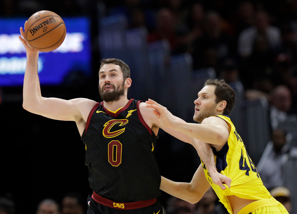 . Cleveland Cavaliers\' Kevin Love (0) grabs a rebound ahead of Indiana Pacers\' Bojan Bogdanovic (44), from Croatia, in the second half of Game 7 of an NBA basketball first-round playoff series, Sunday, April 29, 2018, in Cleveland. The Cavaliers won 105-101. (AP Photo/Tony Dejak)