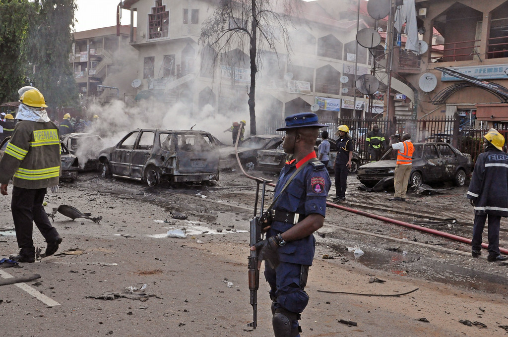 . Rescue services work at the scene of  an explosion, in Abuja, Nigeria, Wednesday, June 25, 2014.  (AP Photo/Olamikan Gbemiga)