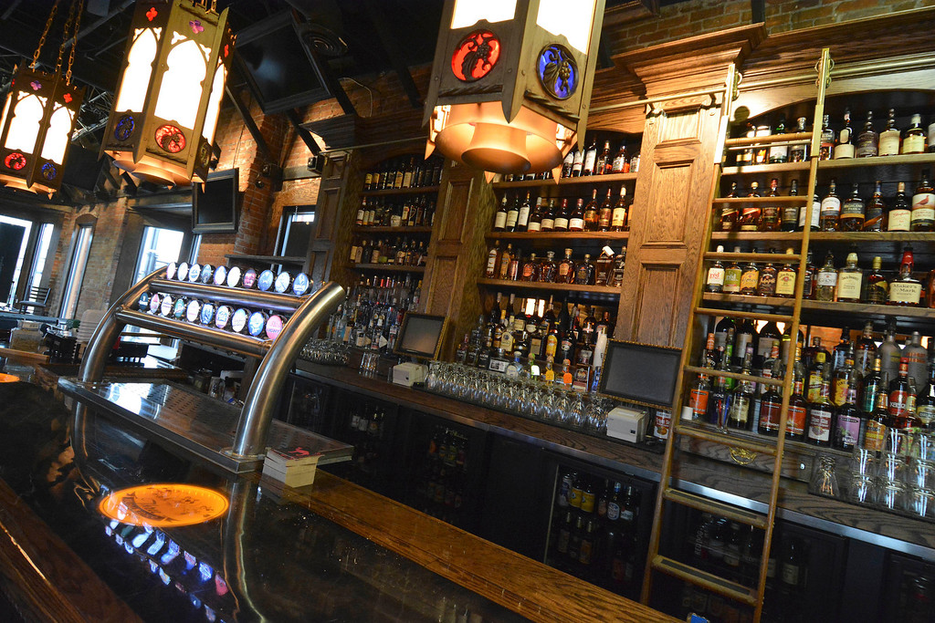 . The upstairs bar at Three Blind Mice in Mount Clemens has the same wood and brass trim, with cathedral lamps overhead. Ray J. Skowronek/Digital First Media