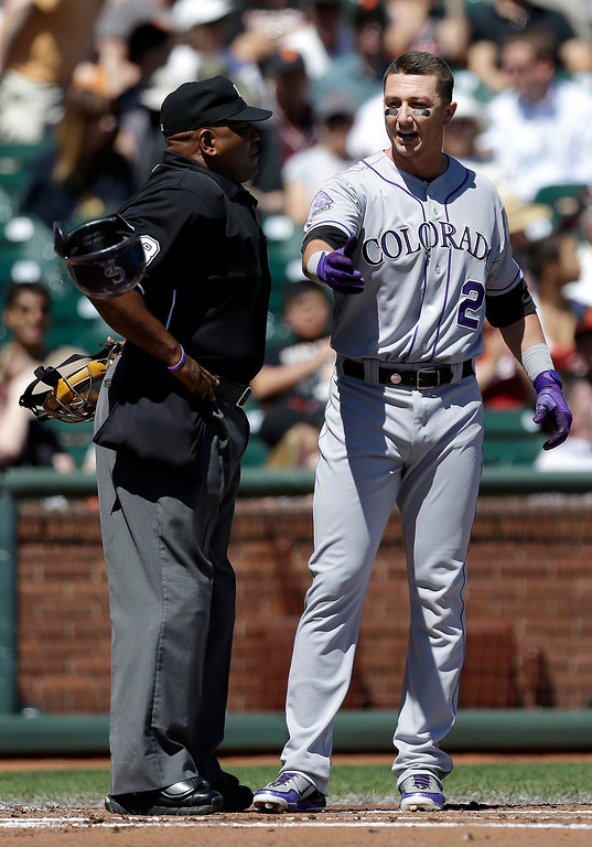 . Colorado Rockies\' Troy Tulowitzki (2) tosses his helmet after being called out on strikes by umpire Laz Diaz during the first inning of a baseball game against San Francisco Giants in San Francisco, Wednesday, April 10, 2013. (AP Photo/Jeff Chiu)