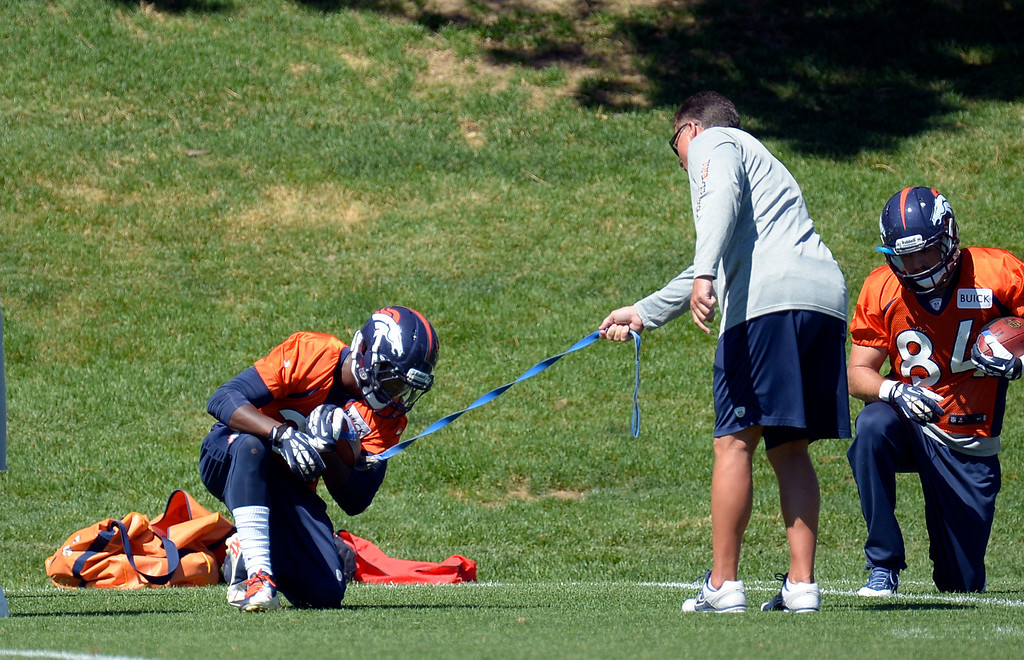 . Denver Broncos running back Ronnie Hillman (21) works on a drill during practice  August 26, 2013 at Dove Valley. (Photo by John Leyba/The Denver Post)