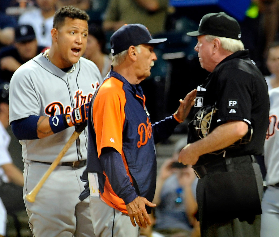 . Detroit Tigers\' Miguel Cabrera, center left, argues with umpire Brian Gorman with Tigers manager Jim Leyland, center, after he was ejected during the first inning of their baseball game against the White Sox in Chicago on Monday, Sept. 9, 2013. (AP Photo/Matt Marton)