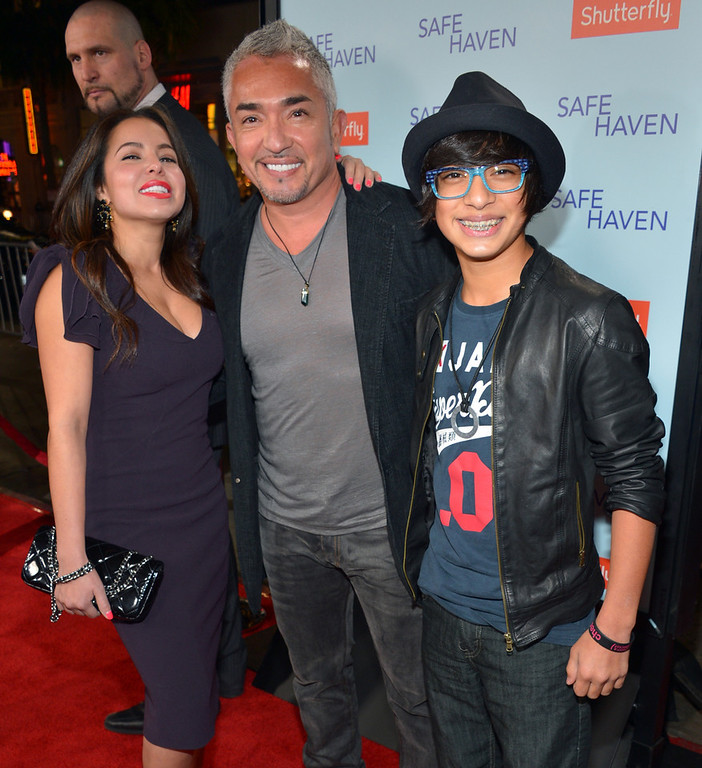 ". Dog Whisperer Cesar Millan (C) and family arrive at the premiere of Relativity Media\'s ""Safe Haven\"" at TCL Chinese Theatre on February 5, 2013 in Hollywood, California.  (Photo by Alberto E. Rodriguez/Getty Images for Relativity Media)"
