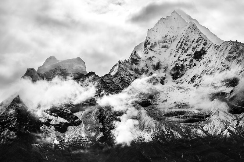 Black and white mountains against a bright sky