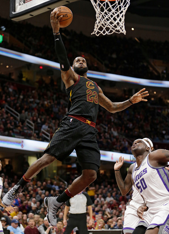 . Cleveland Cavaliers\' LeBron James (23) drives to the basket against Sacramento Kings\' Zach Randolph (50) in the first half of an NBA basketball game, Wednesday, Dec. 6, 2017, in Cleveland. (AP Photo/Tony Dejak)