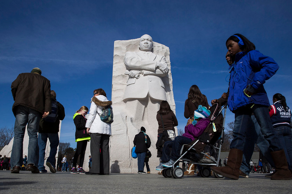 . WASHINGTON, DC - JANUARY 20:  People visit the Martin Luther King, Jr. Memorial, January 20, 2014 in Washington, DC. Americans marked the birth and legacy of civil rights leader Martin Luther King, Jr. (Photo by Drew Angerer/Getty Images)