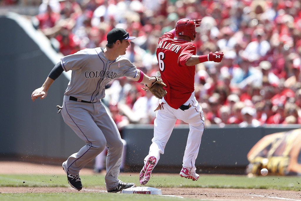 . Billy Hamilton #6 of the Cincinnati Reds reaches first base after a bunt single and would advance to third after a throwing error in the first inning of the game against the Colorado Rockies at Great American Ball Park on May 11, 2014 in Cincinnati, Ohio. (Photo by Joe Robbins/Getty Images)