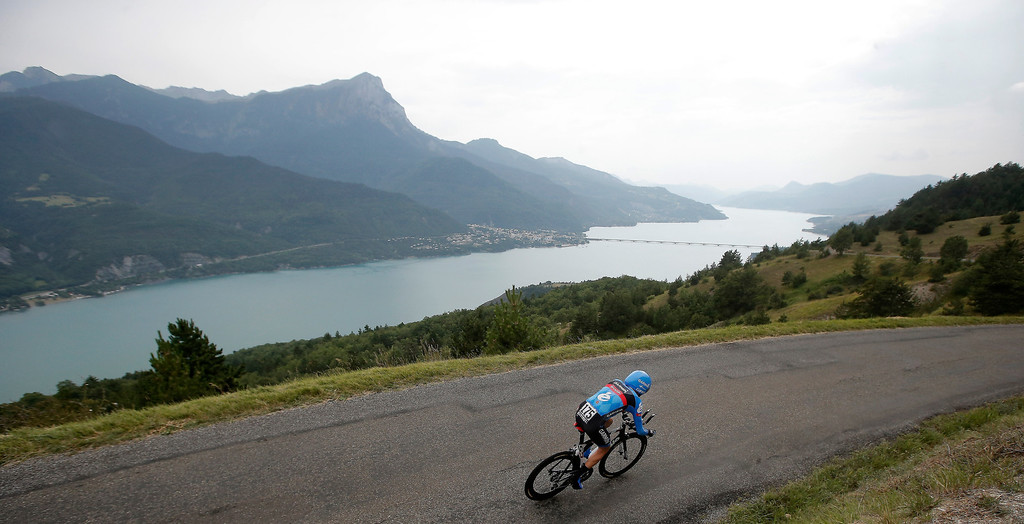 . Daniel Martin of Ireland passes Serre-Poncon lake during the seventeenth stage of the Tour de France cycling race an individual time trial over 32 kilometers (20 miles) with start in Embrun and finish in Chorges, France, Wednesday July 17, 2013. (AP Photo/Laurent Cipriani)