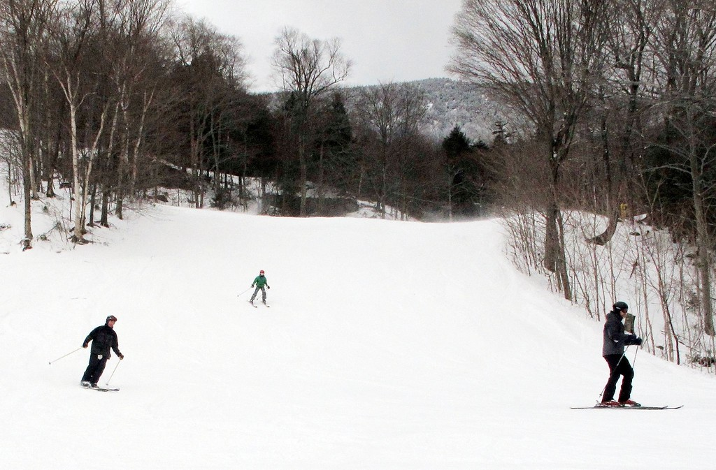 . In this Dec. 30, 2016 photo, skiers descend a slope at Mad River Glen in Fayston, Vt. Ski areas are relishing in new snow a day after a powerful storm dumped 20 inches of snow in parts of Maine, and lesser amounts in other areas. Mad River received 6-8 inches. (AP Photo/Lisa Rathke)