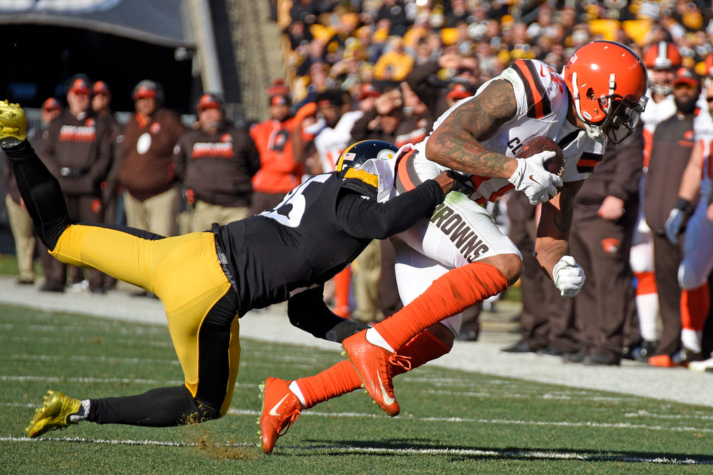 . Pittsburgh Steelers cornerback Artie Burns (25) tackles Cleveland Browns wide receiver Terrelle Pryor during the first half of an NFL football game in Pittsburgh, Sunday, Jan. 1, 2017. (AP Photo/Don Wright)