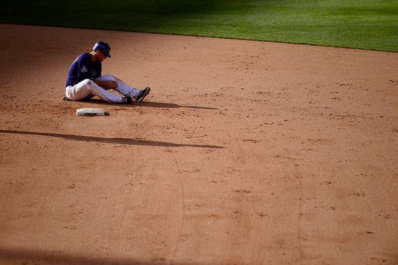 . DJ LeMahieu (9) of the Colorado Rockies sits in the dirt after getting out in a double play on a ball hit by Michael Cuddyer during the Dodgers\' 10-8 win in Denver on Monday, September 2, 2013. The Colorado Rockies hosted the Los Angeles Dodgers at Coors Field. (Photo by AAron Ontiveroz/The Denver Post)